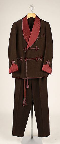 This smoking jacket and pants were worn in place of dinner jacket at home. It was indicative of the edwardian period. This one is silk and velvet and can be seen with braided frogging