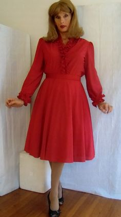 tgirl in vintage red long sleeve dress and petticoat