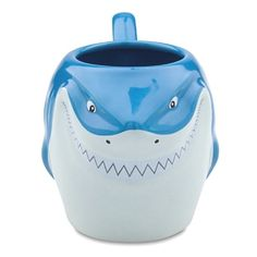 """New.  Sculptured features of Bruce the Shark from Finding Nemo.  Ceramic.  Holds 20 oz.  4"""" H x 7 1/2"""" W  Microwave and dishwasher safe."""