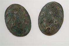 Oval brooches - Bronze, iron, white metal, textiles. The brooches have iron nails with remains of textiles. The gripping-beast ornamentation was originally partly overlaid with silver. Grave find, Björkö, Adelsö, Uppland, Sweden.  SHM 34000:Bj 637 Viking