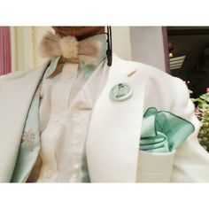 """A little bit of an upclose look on the details of what I wore to this last weekend's Dapper Day at Disney Parks. Vintage 1960s/ 70s Rabbit fur clip-on bow tie by @joyridevintage shop in Downtown Orange CA. Vintage green handkerchief also from that shop. Vintage green detachable starched collar. Vintage """"spring"""" themed green and peach floral brocade waistcoat to pair perfectly with the pastel peach pants I wore that day. And I really wanted some kind of floral bouttoniere but found…"""