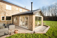 Beautiful conservatory with the light weight tiled Ultraroof from Ultraframe.