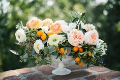 Citrus Compote Tutorial featuring roses, ranunculus, seeded eucalyptus and kumquats by Emblem Flowers