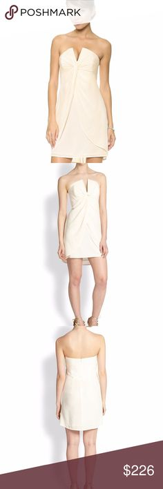 NWT Zimmermann Twist Front Silk Strapless Dress 0 ZIMMERMANN  Size AU 0, US 2- 4  NWT  Ivory Silk  Plunging V neckline Strapless Gathered twist front center Above the knee Draped split front overlay Hidden back zip closure  CHEAPER on E - BAY! Zimmermann Dresses Strapless