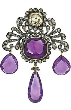 A 19th century amethyst, diamond and gem brooch  The central cushion shaped amethyst collet in rose-cut diamond surround, to a rose-cut diamond scroll design surmount with pale yellow foiled gem and rose-cut diamond cluster, suspending three later pear shaped amethyst drops, 5.1cm wide