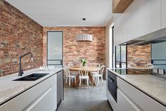 Mark St, Fitzroy North Kitchen, Dining Room, concrete floors, exposed brick wall, steel windows and doors, pendant light