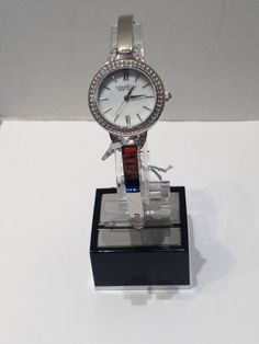 Ladies Caravelle New York white bangle style with crystals Bangles, York, Watches, Crystals, Lady, Accessories, Style, Fashion, Bracelets