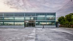 waterfrom design transforms a old factory specializing in water dispenser production and sales using transparent plastic sheets and mesh. Industrial Architecture, Contemporary Architecture, Architecture Details, Library Architecture, Transparent Plastic Sheet, Front Courtyard, Interior Design Awards, Water Ripples, Steel Beams