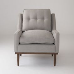 Typified by a thoroughly modern but understated elegance, the Jack Chair has a presence that defies its low-profile stature. A faithful reproduction of a vintage piece we fell in love with while antiquing, every detail – from the splayed hardwood legs and low-slung arms to the subtly tufted cushion – is an ode to mid-century design. With a solid wood frame and plush cushioning, this chair is an effortless and comfortable addition to any interior.