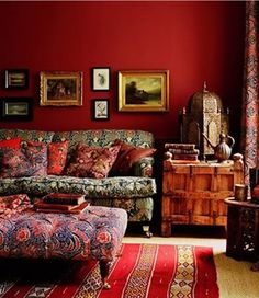 living-room-red-painted-walls-european-decorating-home-ideas...  LOVE THE WALLS...LOVE THE FURNITURE, THE MOROCCAN LAMP, ETC., BUT, NOT SO MUCH, THE SMALL PAINTINGS ABOVE THE COUCH...I JUST HAVE NEVER LIKED PAINTING JUST ABOVE MY HEAD LIKE THAT...BEAUTIFUL ROOM...DEEPLY WARM & INVITING...AND ROMANTIC...