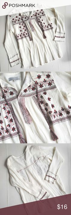 """Boho Embroidered Peasant Blouse tassels M 036 Loose and flowy. A soft crepe feel, 100% cotton. Ivory, barely off white color. Embroidery and tassels in maroon and navy.  Made by World Market. Labeled a Small/Medium, please see measurements. I would say M/L. Very good condition.  Bundle up and save! Chest, layed flat:  20"""" Sleeves:  21"""" Length:  26"""" world market Tops Blouses"""