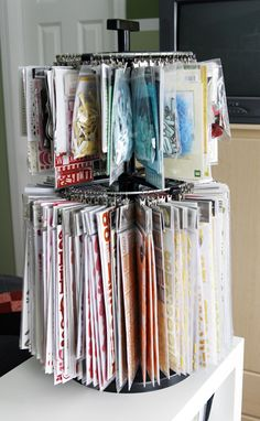 Spinning racks, such as the Clip It Up*, are perfect for so many different types of supplies. I use mine to hold letter stickers and rub-ons  *(https://clipitup.com/index.cfm?CFID=13482715=a723b6d5f3bcf535-522CC005-A5F5-4A8E-0B1794E8663E46D8=8e3045cfd77851345d2348141b7d37633660)