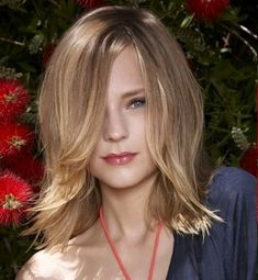 These bangs would drive me crazy all in my face! But something like this for my growing out layers maybe...