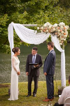 Riverside wedding ceremony with built arch