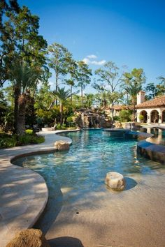 This pool is fantastically designed for those who want to escape to a tropical paradise in the comfort of their own home. Looks just like a tropical paradise with a beach-like entrance.