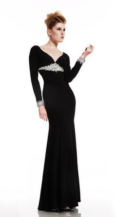 One of the most sophisticated looks in the collection, this black stretch matte jersey gown is encrusted with a/b crystals under the bust and at the cuffs of the sleeves.