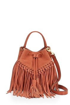 Rapture Bucket Bag - Tassel time. This is a right-now bucket bag made fresh (not to mention festival-ready) with tons and tons of tassels. The main compartment features a drawstring closure and you've got carry options, too. Grab the top handle for ladylike vibes or sling it crossbody for that hands-free life.     Please note this style is on pre-order and is estimated to ship on or before March 15th, 2017.        Style #: HSP7IRHU19