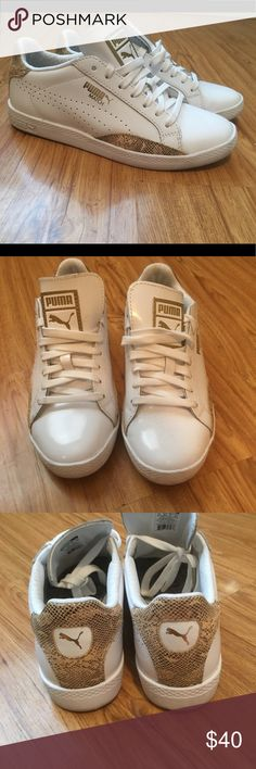 Pumas. White and gold. Simple yet classic tennis shoe, can be styled with everything from mini skirts to tailored pants. Lightly worn once. Puma Shoes Sneakers