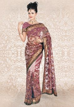 Dusty pink tissue saree designed with resham, zari and patch border work. Available with matching blouse, blouse shown in the image is just for photography purpose. (Slight variation in color and patch patti pattern is possible.) data-pin-do=