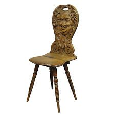 a carved wedding board chair with bacchus ca. 1900