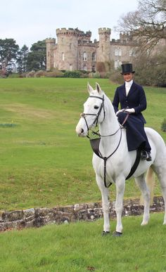 Amy Bryan Dowell riding  Ceilis Bouncer side saddle, fox hunting with the Cheshire hunt from Chelmondley Castle