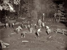 """Wyndygoul Council and War Dance at Medicine Rock circa 1908. Wyndygoul, aka the """"camp of the Pocatopog tribe,"""" was the Cos Cob, Connecticut, estate of writer-naturalist Ernest Thompson Seton, founder of the Woodcraft Indian movement, and one of the founders of the Boy Scouts of America. View full size. 8x10 glass plate negative, George Grantham Bain Collection."""