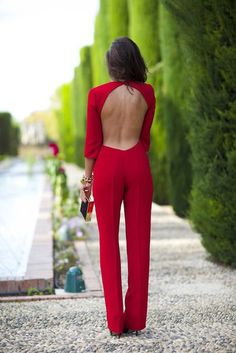 Open back red jumpsuit wedding attendee