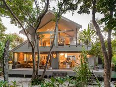 Beautiful beach house near Byron Bay in Australia. Love the sculptural trees and indoor/outdoor spaces with huge glass doors.