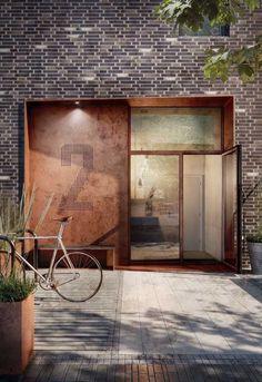 Linda e moderna, essa porta de entrada conta com a rusticidade do aço corten e a elegância do vidro