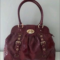 """Braccialini Red Patent Large Elegant Shoulder Bag Braccialini large size patent elegant shoulder bag. Measurements approximately: Length 21"""".    Height 13.5"""" Depth 4.5""""  Strap drop 9.5"""". Gold hardware. Very decent used conditions, no damages. Lining inside shows evidence of wear, no stains. I heard offers!! Braccilini Bags Shoulder Bags"""