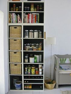 22. Black and White: Painting the inside of the shelves black makes the space feel more unified with the rest of the kitchen. Plus, those baskets are perfect for hiding things you don't really want out on display.
