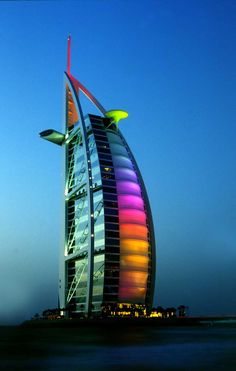 """The Burj Al Arab is one of the major tourist spots in the middle east. It is a very exquisite hotel in Dubai, U. It is also known as, """"The Sailboat of Dubai."""" This is picture of the hotel at night, as it lights up the sky. Hotel A Dubai, Dubai City, Dubai Uae, Dubai Trip, Visit Dubai, Burj Al Arab, Amazing Buildings, Modern Buildings, Hotels And Resorts"""