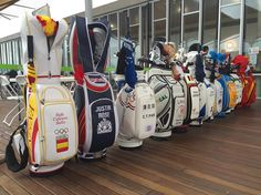 Olympic golf bags all lined up in team colours