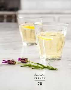 This Lavender French 75 cocktail recipe includes champagne, a squeeze of lemon, and fresh lavender.