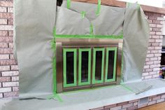 How to Spray Paint a Brass Fireplace, High Heat Rustoleum to Spray Paint a Fireplace Insert, DIY Painted Brass Fireplace, Brass Fireplace Makeover, Reface Fireplace, Wood Paneling Makeover, Stucco Fireplace, Fireplace Doors, Tall Fireplace, Fireplace Update, Fireplaces, Fireplace Makeovers