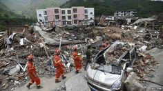 Rescue workers walk past debris of houses at an earthquake zone in Ludian county, Zhaotong, Yunnan province, on 5 August 2014. China earthquake: Toll nears 600 amid flood fears Almost 600 people are now known to have died in the earthquake that hit Yunnan province on Sunday, officials say. The 6.1-magnitude quake struck a mountainous area, destroying thousands of houses and triggering landslides. A total of 589 people were killed and nine were missing, China's Ministry of Civil Affairs said.