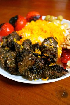 Kabab Torsh is a tasty kabab dish from the north of Iran. The flavour combination of pomegranate, herbs and walnuts make this dish so rich and delicious! Iranian Cuisine, Iranian Food, Lebanese Cuisine, Iranian Art, Indian Dessert Recipes, Dinner Recipes, Goat Recipes, Vegetable Recipes, Arabic Food