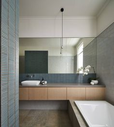 Mixing three unusual tile choices in this bathroom but they somehow work!