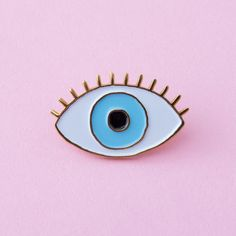 STYLE: Lucky Blue Eye keep at least one eye on the prize when you wear cou cou suzette's eye pin in the dreamiest shade of blue that's the color of a swimming