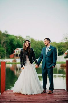 Adorable bride in a black leather jacket. So great for a fall wedding! | http://www.weddingpartyapp.com/blog/2014/09/18/6-awesome-coverups-for-fall-brides-stay-stylish-warm/