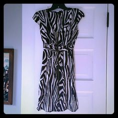 Satin Zebra Dress Perfect dress for work or a date night out. Satin - feel material for a soft, comfortable wear with a luxurious feel. Worn less than a handful of times. Gold zipper rubs full length of dress. Sniched waist and v-neck line creates a flattering fit. Hits about knee-length. Great condition, no flaws. H&M Dresses Midi