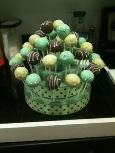 cake ball pops for baby shower.  glued Styrofoam circles from craft store together and wrapped with ribbon.