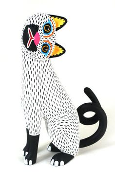 "Oaxacan wood carving master Luis Pablo, ""Snow White Cat."""