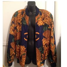 Authentic Chanel Vintage Bomber Jacket. Make offer Authentic Chanel Vintage Silk Bomber Jacket. I want to say it's a size Large. Will look good on a size medium too if you want the oversize look. Inside passed shoulders. Color is Navy Blue with Gold sunflowers and monogrammed Chanel C Logo as shown. Zipper closure. A little rusted on the bottom maybe can be removed with baking soda. Two front pockets. Taking reasonable offers. Please use counter offer. Everything must go!! CHANEL Jackets…