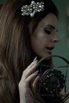Lana Del Rey, the hair, the makeup, and the hair accessory is a my kinda style.