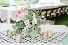 Pink Protea and eucalyptus leaf wedding centerpieces // Aaron and Jillian Photography » Husband and Wife International Engagement & Wedding Photographers based in Charleston, South Carolina.