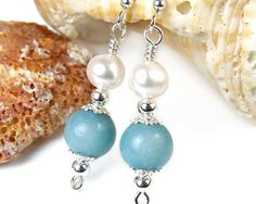 These handmade earrings are a lovely combo of blue amazonite gemstone beads, white freshwater pearls, and sterling silver beads, wire, and ear hooks.
