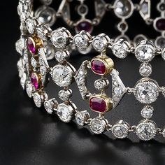 Stunning Edwardian Diamond and Ruby Bracelet // A rare and majestic Belle Epoch bracelet glistening with 12.50 carats of old mine-cut (plus a few rose-cut) diamonds, and highlighting a double row of ravishing red Burmese rubies totaling 5.00 carats. This extraordinary Edwardian bracelet is crafted in platinum with yellow gold bezel settings for the rubies and measures 7 1/4 inches long by 13/16 inches wide. A wonderful and romantic original Edwardian treasure, circa 1900.