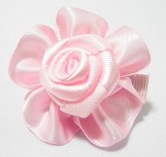Plain Rose Baby Hair Clip Pink. 4cm (L) by 4cm (W). Ideal for children from 1 1/2 year old onwards. 1 for $1.50. Like us at https://www.facebook.com/pages/ChucklingBaby/675475065907287.