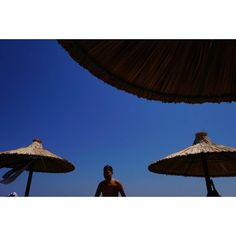 Untitled #skantzman #heraklion #crete #beach #colour #boy #ombrela #manolisskantzakis #colour #photography #sonya6000 #28mm #sky